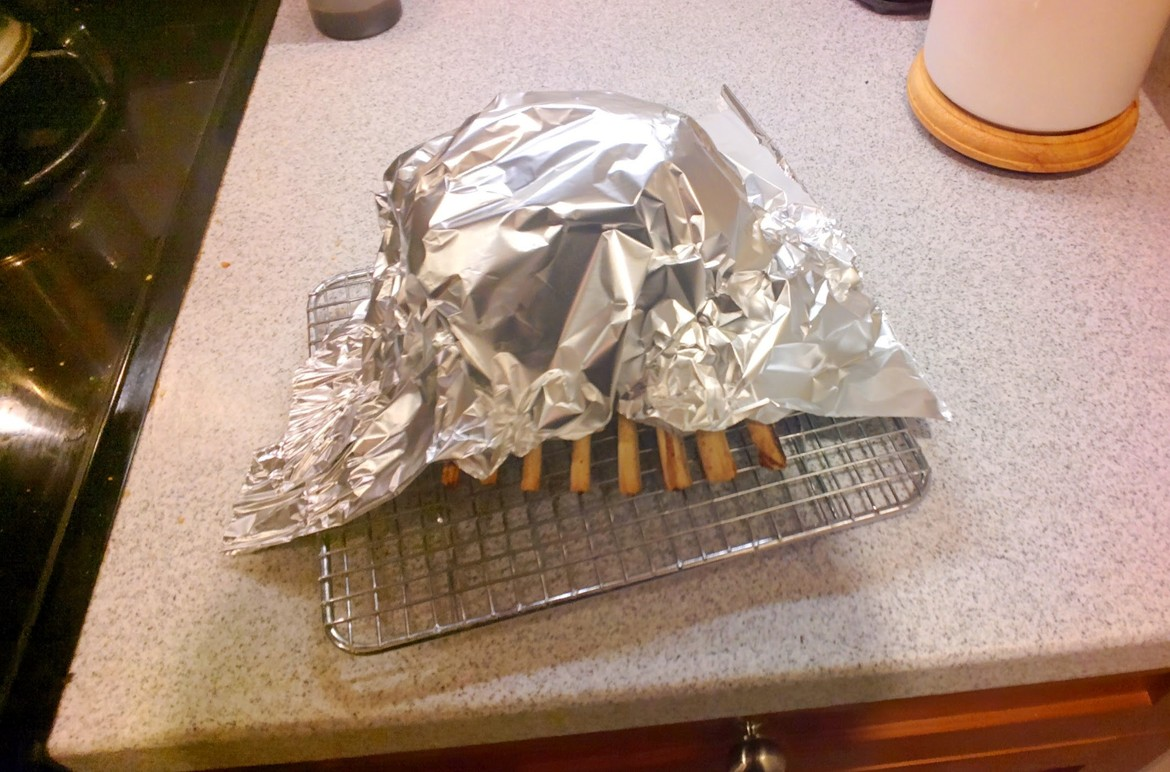 Foil covered rack of lamb
